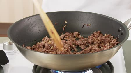 short clip : Minced meat being fried in a pan