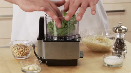 basic steps : Pesto ingredients being mixed together