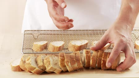 short clip : Baguette slices being placed on a wire rack