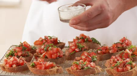 common salt : Bruschetta being sprinkled with salt