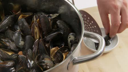 being removed : Closed mussels being removed from the pot Stock Footage