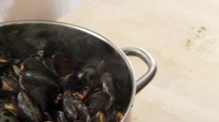 basic steps : Chopped parsley being added to mussels