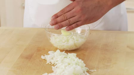 basic steps : Diced onion being tipped into a bowl