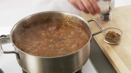 hotpot : Goulash being seasoned with pepper, salt and ground cumin Stock Footage