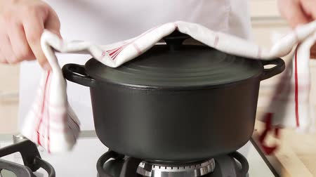 being removed : The lid being removed from a roasting pot Stock Footage