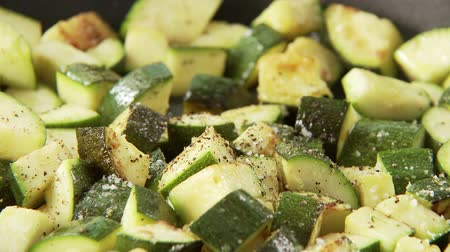 common salt : Fried, diced courgette Stock Footage