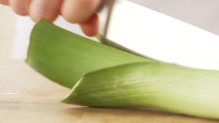 halve : A leek being cut in half lengthways and chopped Stock Footage