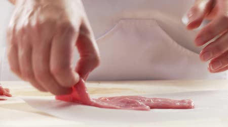 veal escalope : Veal escalope being tenderized with the balls of the hand