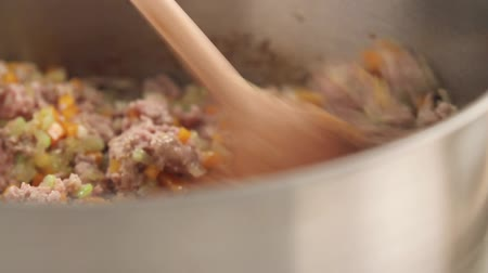 basic steps : Minced meat and vegetables being stirred