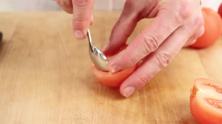 basic steps : Peeled tomatoes being halved and deseeded