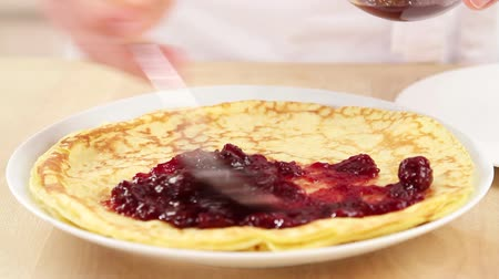 basic steps : Crepes being spread with jam Stock Footage