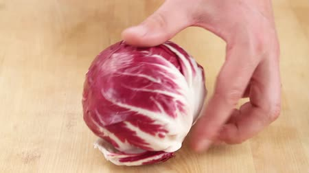 halve : Radicchio being cleaned Stock Footage