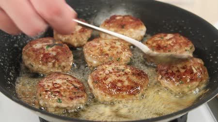 basic steps : Butter being added to frying burgers