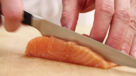basic steps : Salmon fillet being sliced