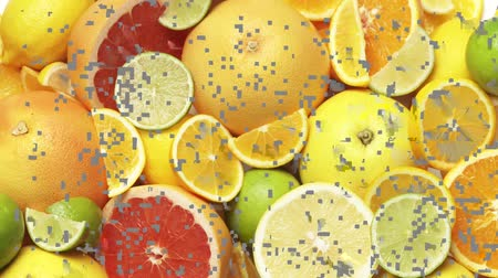 entire frame : Whole and halved citrus fruit Stock Footage