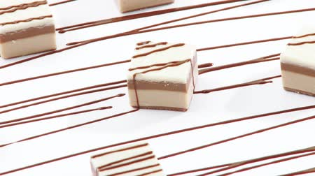 pivoting : Sweets with chocolate drizzle Stock Footage