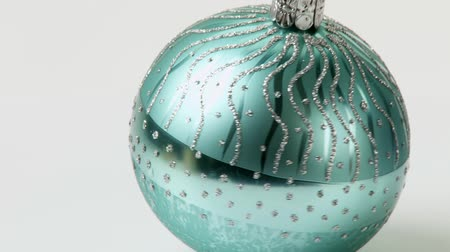 trimmings : A turquoise Christmas bauble
