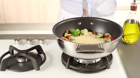 frypan : Couscous being added to vegetables Stock Footage