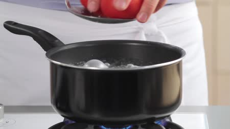 blanching : Placing tomatoes in boiling water