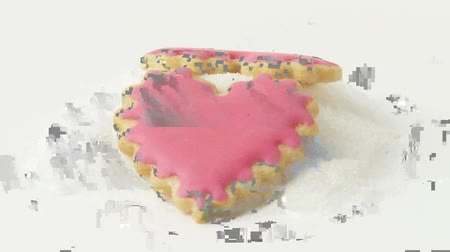 kalp şekli : Heart-shaped biscuits with pastel-coloured icing Stok Video