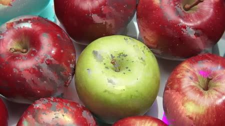 entire frame : Red apples with one green apple