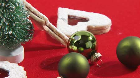 trimmings : Jam biscuits and Christmas decorations Stock Footage