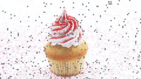 outlinable : Cupcake with cream topping and coloured sugar Stock Footage