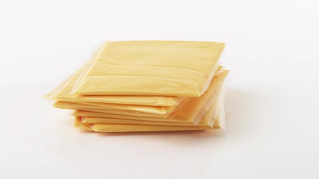 cling film : Cheese slices Stock Footage