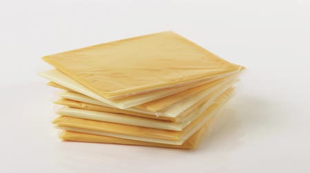 clingfilm : Cheese slices (different cheeses)