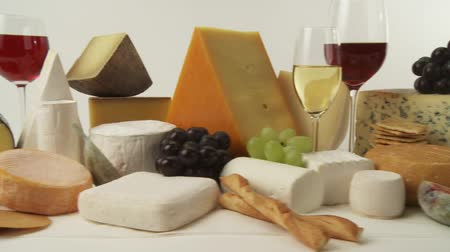 pieces of cheese : Various cheeses with wine, grapes and savoury biscuits