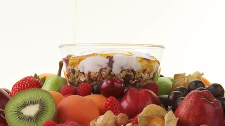 Assorted fruit and muesli with yoghurt and honey