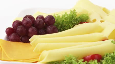 being cut up : Cheese platter with grapes Stock Footage