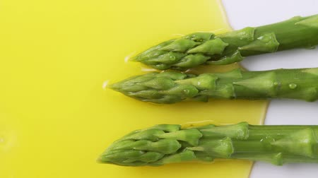 plating food : Plating up green asparagus with melted butter