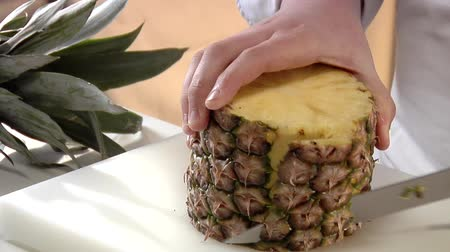 Peeling a pineapple