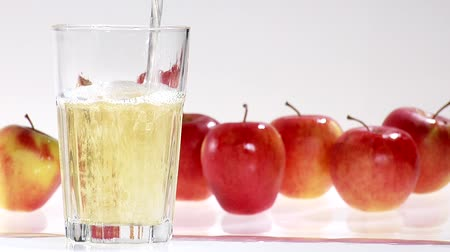 poured out : Pouring apple juice into a glass