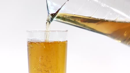 poured out : Pouring apple juice from a jug into a glass
