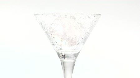 poured out : Pouring Martini into a glass with ice in it