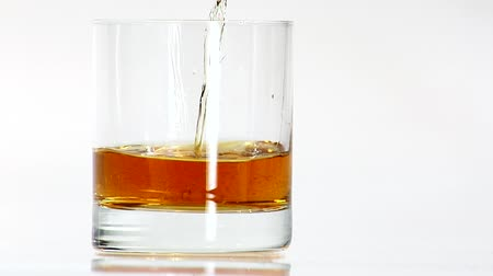 outlinable : Pouring whisky into a glass Stock Footage