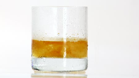 outlinable : Pouring whisky into a glass of crushed ice