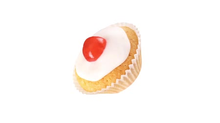 outlinable : A cupcake with a glacé cherry