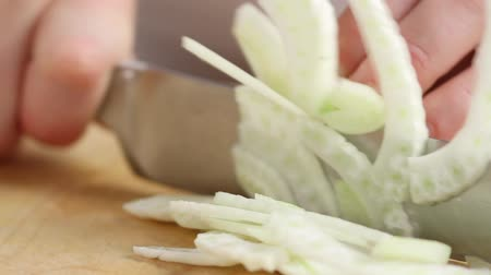 being cut up : Slicing fennel finely