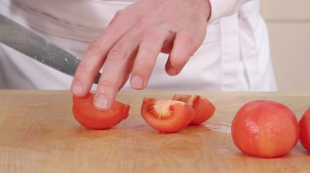 очищенные : Peeled tomatoes being quartered and deseeded