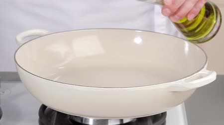 frypan : Pouring oil into a deep frying pan