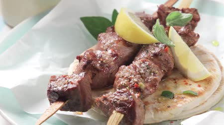 yazlık : Souvlaki (Greek meat kebabs) on a pita bread