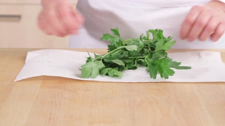 plucked : Parsley being patted dry and leaves being removed