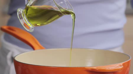 poured out : Oil being added to a saucepan Stock Footage