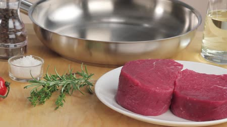 frypan : Beef fillet steaks, herbs, spices, a pan and oil