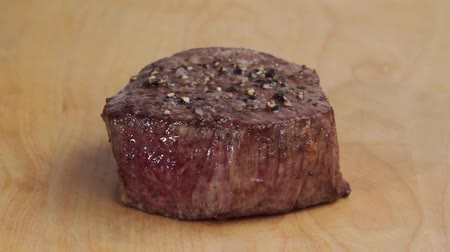 cutting up : A sliced fried fillet steak (medium rare) Stock Footage