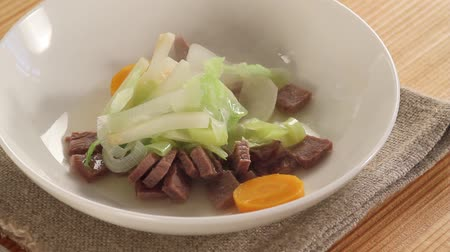 hotpot : Pot-au-feu being place on a plate Stock Footage