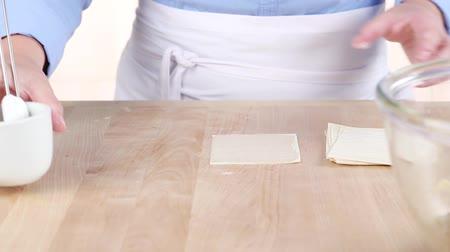 wontons : Won ton sheet being brushed with egg white